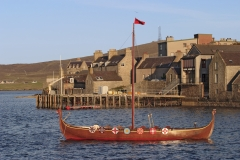 Long ship on Lerwick's coastline